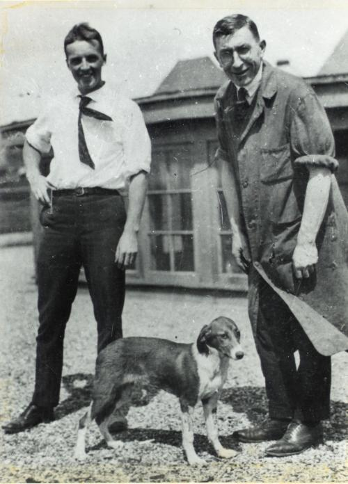 Photograph of Banting and Best with a dog on the roof of the Medical Building, University of Toronto.