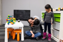 Student with her two children in the Family Study Space